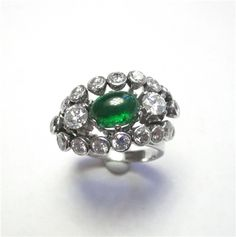 Emerald & Diamond Ring - This antique ring has 1.50ct of emerald and 2.15ct of diamonds. The stones are set in 14kt white gold. 101-A184 (subject to prior sale) – Lilliane's Jewelry – 4101 W. 83rd St. Prairie Village, KS 66208 – 913-383-3376 –