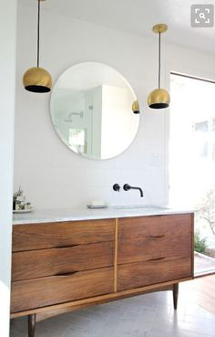 Everyone loves a twist. There& a new take on the classic bathroom that we& seeing over and over, and it& easy to get the style at home if you& considering a bathroom makeover. In fact, a modern classic bath can be broken down into three key elements. Diy Bathroom Vanity, Bathroom Renos, Bathroom Renovations, Bathroom Furniture, Bathroom Ideas, Bathroom Cabinets, Bathroom Lighting, Bathroom Pictures, Remodel Bathroom