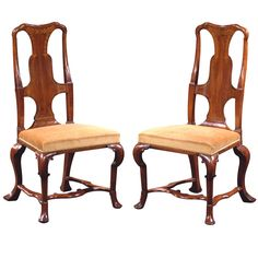 A Fine Pair of Early George II Irish Walnut and Marquetry Side Chairs, Circa 1710 - Each with yoked top rail over a shaped backsplat inlaid with foliate sprays and boxwood and ebonised stringing; the overupholstered seat raised on four cabriole legs headed by C-scrolls and joined by an H-form stretcher, terminating in pad feet. -  Hyde Park Antiques, Ltd., New York