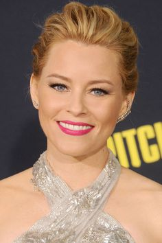 Who: Elizabeth Banks What: Rich Pink Lips How-To: The actress gave her classic red carpet look a warm weather update with a shade of rich pink lipstick that was feminine but not girly, long, dark lashes and a healthy dose of warm bronzer. Pair statement ear cuffs with simple eye makeup so the two don't compete. Editor's Pick: Clinique Pop Lip Colour + Primer in Wow Pop, $18, sephora.com.   - HarpersBAZAAR.com