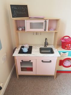 Ikea duktig kitchen make over using rust-oleum satin finish furniture paint in pink champagne amd marble effect contact paper for the worktop