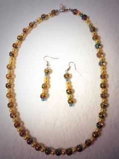 Beautiful confetti glass beads and yellow glass pearls and blue seed beads