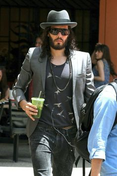 A hairy looking Russell Brand holds onto a green juice drink as he arrives at the Federal Building in Los Angeles. Brand can be seen keeping...