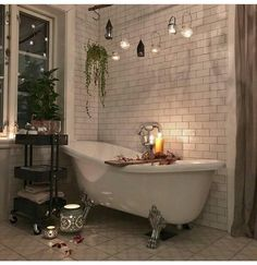 clawfoot tub, subway tile