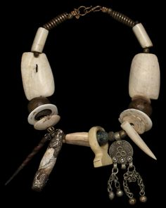 by Marion Hamilton. Necklace, 19th century: shank shell beads from Mauritania + New Guinea Conus shell currencies + Ivory Ring Dinka people + bronze from Nigeria + Tibet amulets + Indonesia + Central Asia (camel bone) + spindle whorl Sassanian (c.300AD) = 2,000$.