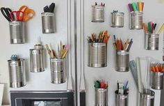 Tuck Art Supplies into Salvaged Tin Cans. | 19 Insanely Clever Organizing Hacks
