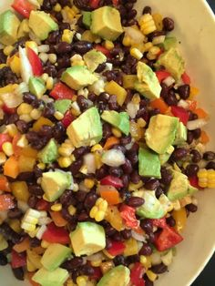 This Southwestern Black Bean and Corn Salad made with bell peppers and avocado and a light lime dressing is super popular and addictive.  from Katie Workman.themom100.com #veggiecrack