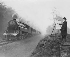 Railway poster artist Norman Wilkinson sketches moving trains on the LMS railway near Watford 1936