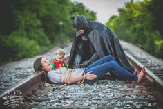 Wisconsin-based photographer Eric Thiele took the superhero-inspired photos of Mike and Roxanne Daly and their toddler son, and one of the pictures blew up after being posted onto Facebook by Unilad. | This Batman-Themed Family Photo Shoot Will Make Every Superhero Fan Want To Have A Baby