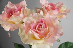 """3.99 SALE PRICE! Each pink rose spray features a beautiful large blossom that stretches 5"""" wide. The silk rose stands 27"""" tall and is 10"""" wide..."""