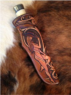 Image result for tooled leather knife sheath