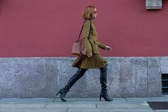 Pleated olive coat and over-the-knee boots