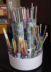 decorated empty toilet paper and paper towel tubes with fabric (or paper or painted) and inserted into a kitchen utensil holder