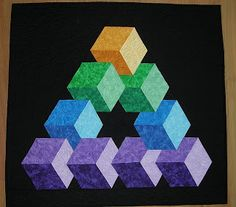 "Here are two of my 3D quilts, ""Impossible Triangle"" and ""3D Color Study"".   Check out all of my quilts in the listed folders under ""My Quilt..."