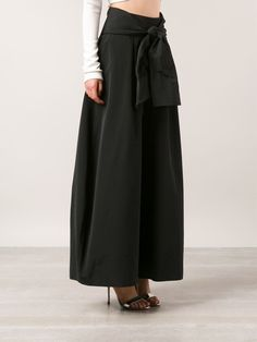 Black silk wide leg trousers from Rosie Assoulin featuring a concealed side zip fastening, a high rise, side seam pockets, pleated details, a long length and a detachable sash.