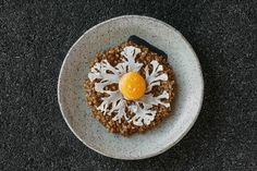 Native rice risotto, black garlic, cauliflower and confit yolk at EXP. Image credit: Dom Cherry