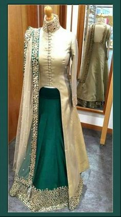 Green Silk Designer Lehenga With Long Choli Modernistic Rama Green Silk Designer Lehenga With Off White Long Choli Snazzy rama green and off white silk long choli lehenga which is classily made with pseudo mirror work. Indian Gowns, Indian Attire, Pakistani Dresses, Indian Outfits, Indian Lehenga, Indian Wear, Long Choli Lehenga, Anarkali, Bridal Lehenga