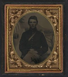 (c. 1861-1865) Soldier in Union uniform in front of painted backdrop showing military camp