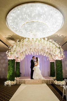 Floral & Hedge Chuppah Photography: Fred Marcus Studio Read More: http://www.insideweddings.com/weddings/pink-purple-garden-inspired-tented-wedding-in-new-york/624/