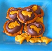 Chocolate, gold fish, and pretzels for a sweet ocean snack.  (I would probably use white chocolate with blue food coloring.)