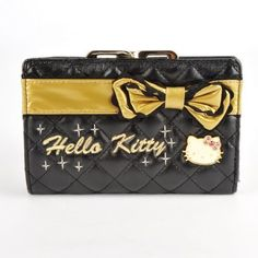 """Hello Kitty Gold Bowknot Clutch Wallet Card Coin Purse by Hello Kitty. $30.80. Length x Width x Height (Folded): 6.1'' x 3.9'' x 1.4'' (15.4 x 10 x 3.5 cm). Color: Black & Gold mainly. Length x Width x Height (Unfolded): 7.8'' x 3.9'' x 0.6'' (19.7 x 10 x 1.5 cm). ·Made of faux leather, soft and durable  ·Snap button closure  ·Metal Hello Kitty face decoration & a gold soft bowknot designed on the front while gold """"Hello Kitty"""" characters embroidered on it  ·1..."""