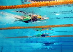 Bronte Barratt and Kylie Palmer of Australia compete during the Swimming Women's 200m Freestyle preliminaries heat three on day eleven of the 15th FINA World Championships at Palau Sant Jordi on July 30, 2013 in Barcelona, Spain.
