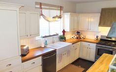 white kitchen with faux reclaimed wood countertops, The Ragged Wren on Remodelaholic
