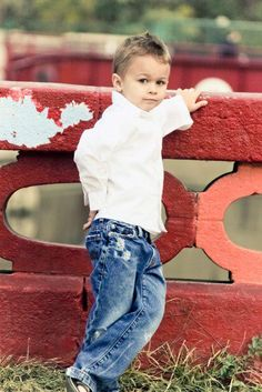 Children photography. A cute little boy's pose