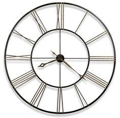 """The """"Postma"""" is an incredible 49"""" diameter wrought-iron wall clock finished in aged black with applied antique gold numerals."""