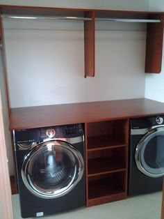 Washer and dryer in a master closet with space to hang and store your soaps.