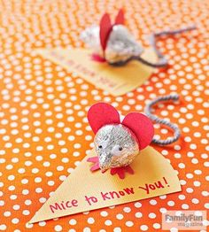Made of two chocolate Hershey's Kisses and a heart-shaped set of ears, these tiny critters are almost too cute to eat.                 Download and print the ear and foot templates below. Cut the shapes from card stock. Remove the paper flags from two Hershey's Kisses. Fold the feet where shown on the template, then use tacky glue to sandwich the feet and ears between the Kisses. Glue a 4-inch length of gray yarn to the underside of the back Kiss. Add googly eyes. Attach the mouse to a c