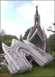 London: A British designer has made what he says is the world's first inflatable church - a grey plastic building with a blow-up organ, pulpit, altar, Gothic arches and fake stained glass windows.