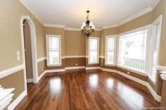 Crown molding in the middle of the wall to break up the space. Would look nice in a dining room to fancy it up.