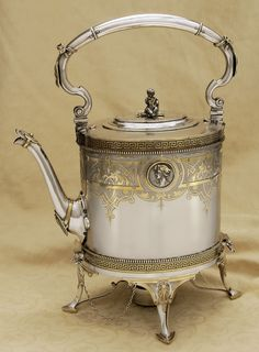 Magnificent Gorham parcel-gilt sterling kettle and stand, with an unusual medallion and a cherub finial, c1861-1867 (replacements)