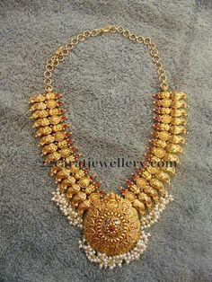 22 carat gold broad mango necklace from Mor Jewellers, featuring intricate design and studded with rubies. The necklace has pearl clusters hanging at its bottom. For inquiries contact: info Indian Jewellery Design, Latest Jewellery, Indian Jewelry, Jewelry Design, Indian Necklace, Antique Necklace, Antique Jewelry, Pendant Jewelry, Beaded Jewelry