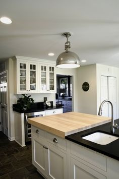 Love the cabinet hardware and butcher block counter top.