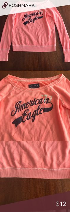 Melon colored American eagle crew neck sweatshirt A bright melon colored American eagle sweatshirt with a crew neck. Perfect color and sweatshirt for cool spring and summer day/nights. American Eagle Outfitters Tops Sweatshirts & Hoodies