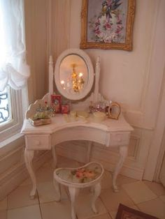 The little dressing table with its many perfume bottles is a 'Small Pleasures Kit'... Une Petite Folie attic bedroom