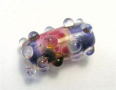 A stunning handmade lampwork glass raised dot focal bead by the bead artist…