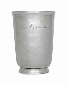 "THE WILLIAM MANLEY SILVER BEAKER -  MARK OF JOHN CONEY, BOSTON, CIRCA 1715 -  Of bell form, on circular molded base, the body engraved on side: ""Ex dono M / WP to South Church"" and scratch-engraved 1715 under base, marked on body with Kane mark C  5 ¾ in. (14.4 cm.) high; 10 oz. (314 gr.)"