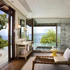 Hill top villa at Four Seasons Resort Seychelles. Experience panoramic views of the ocean from the bath!
