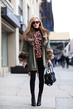 Street style favorite and Harper's Bazaar Editor Joanna Hillman mixes print, leather and fur. NYFW Fall 2012.