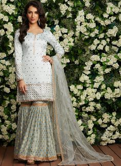 Description Light Blue Brocade Gharara Suit features a dhupioni silk kameez with santoon inner, brocade bottom and net dupatta. Embroidery work is completed with sequins, stone and threadwork embellishments. Pakistani Dress Design, Pakistani Dresses, Indian Dresses, Indian Outfits, Gharara Designs, Kurta Designs, Saree Blouse Designs, Indian Designer Outfits, Designer Dresses