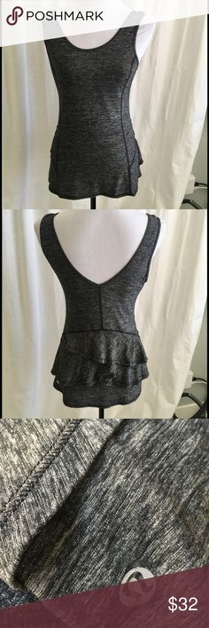 Lululemon Gray Hustle Bustle Ruffle Tank Super cute tank with scoop in front and V in back. Marled black and gray. No size found in garment so estimated. Bust 16.5. lululemon athletica Tops Tank Tops