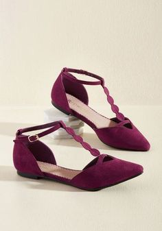 Buckled into these faux-suede flats by Restricted, you trot over to your bestie's apartment for a quick hello. From the moment these T-straps - flaunting circular details, toe cutouts, and a vibrant raspberry hue - step over the threshold, their style earns her immediate praise, making the interaction all the more memorable!