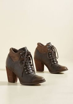 Rise From the Asheville Bootie | Mod Retro Vintage Boots | ModCloth.com Stand out amongst the local venues and hip scenes of the city in these brown booties! Touting soft textile ankles, faux-leather uppers with chic perforations, and stacked heels, this brogue-inspired pair perfectly embodies the downtown vibes of one of your favorite cities.