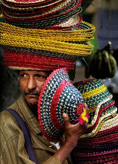 Kolkata, India: A vendor sells hats made from palm leaves  Photograph: Bikas Das/AP