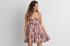 AEO Tiered Babydoll Dress  by  American Eagle Outfitters | Featuring a spring-ready strappy back and a free-spirited floral print.  Shop the…