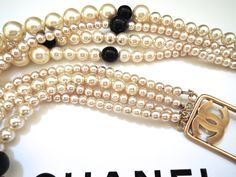Chanel Substantial 4 strands golden coloured pearl and black glass bead necklace. From 2003P. In pristine condition.