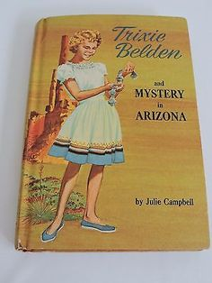 Title: Trixie Belden and Mystery in Arizona Author: Julie Campbell Year: 1958 Condition: It is in excellent condition for its age. The pages are tight. The front page has a written inscription reading